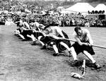 A team get the winning pull at the tug-of-war event., 1