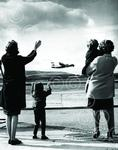 A family wave off a BEA Herald as it takes off from Abe