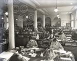 14. Photograph showing a scene from the front office of