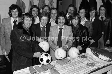 1974 Stags Players Sign Footballs.jpg