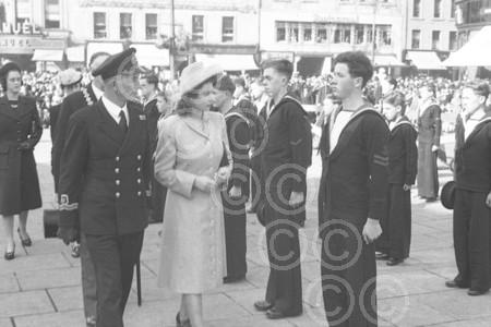 A young Queen Elizabeth inspecting sea cadets in the Ci