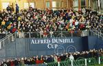 A section of the big grandstand crowd watching Dunhill