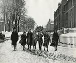 1. A group of ladies slipping in snowy conditions in 19