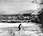 11 A man takes advantage of the heavy snowfall in 1958