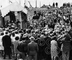 11. A crowd gathers near the beach in August 1965, to w