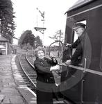 Sam Wright, train driver, accepts a token on the Lamble