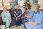 321102M Lilian Holder with nurses in room.jpg