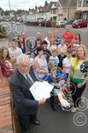361210M Cllr Cotterill and residents of New Village.jpg