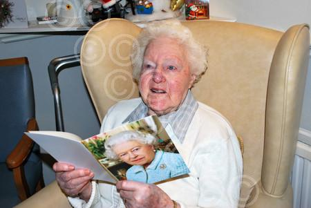 Mary Uprichard 100th Birthday with card from The Queen.jpg